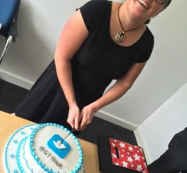 of GYSocialMedia cuts an anniversary cake.